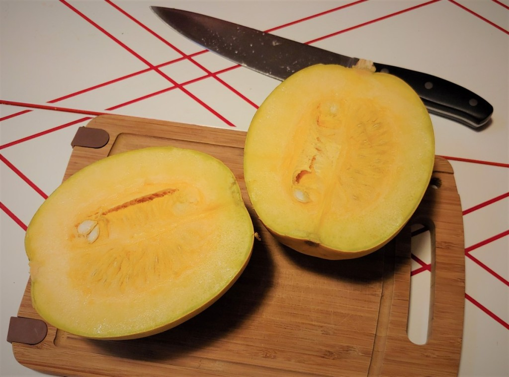 Two halves of an uncooked spaghetti squash