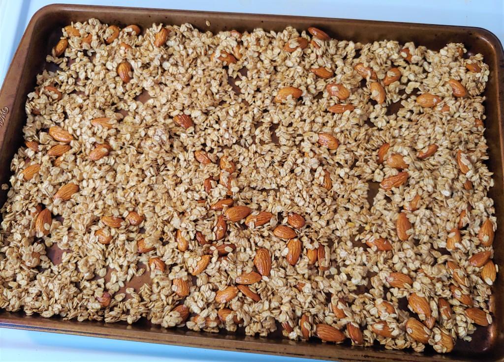 Honey almond granola on a cookie sheet