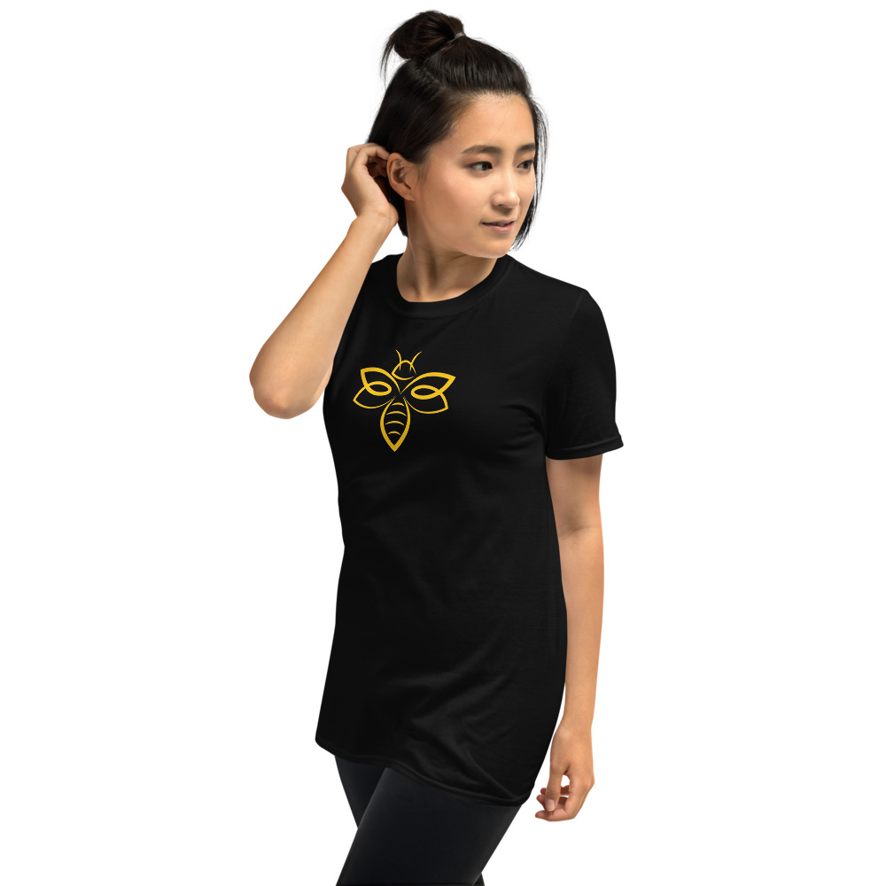 Woman wearing a black T-shirt with a yellow abstract bee design on the front