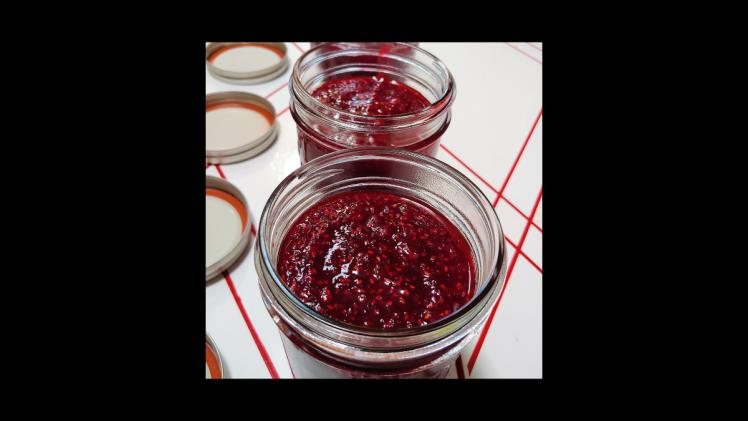 raspberry jam in mason jars
